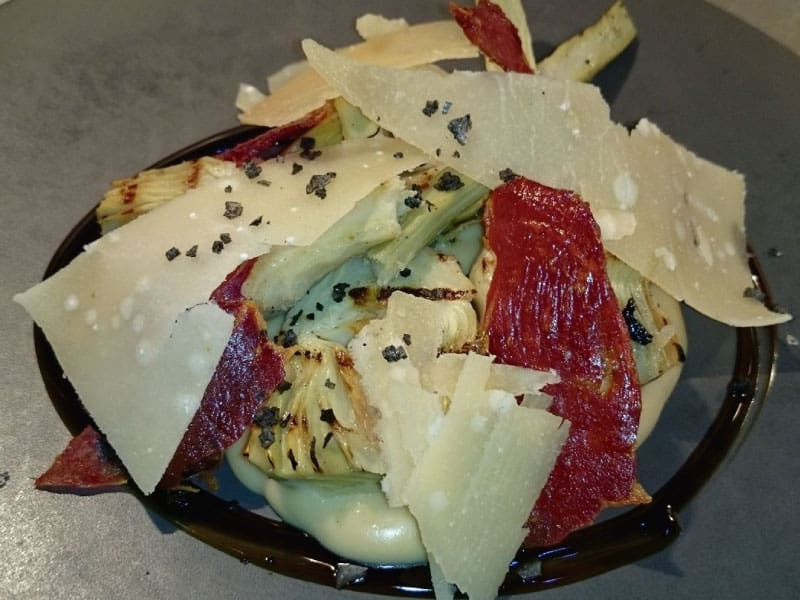 Grilled artichokes with a foie sauce, Iberian ham and parmesan cheese