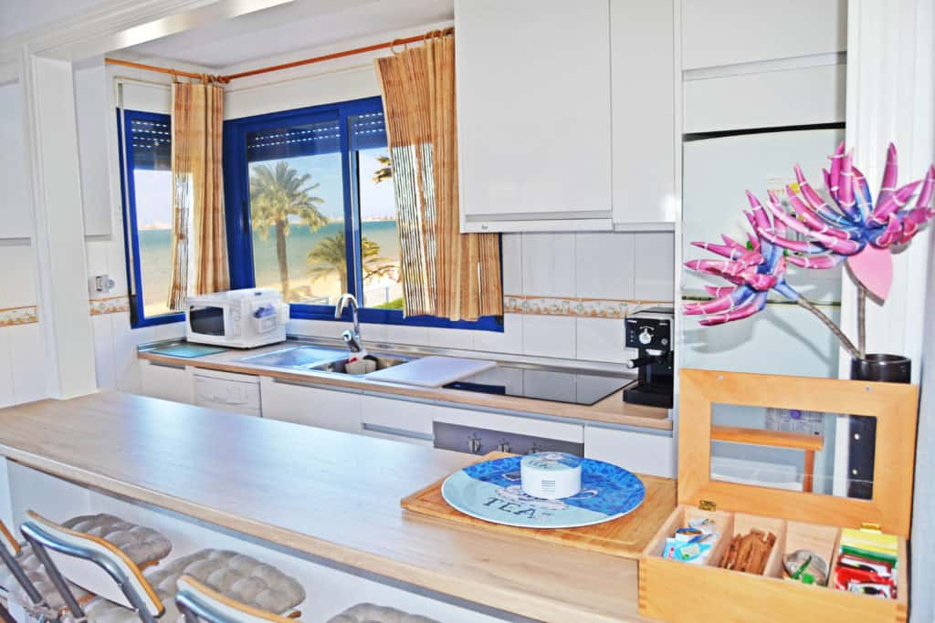 """View from your kitchen <a href=""""https://www.playahondaapartment.com/photos/#Kitchen"""" target=""""_blank"""" rel=""""noopener noreferrer"""">     >>More kitchen photos >></a>"""